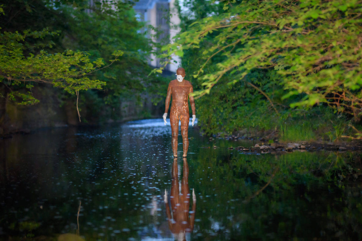 Statue by Gormley wearingPPE