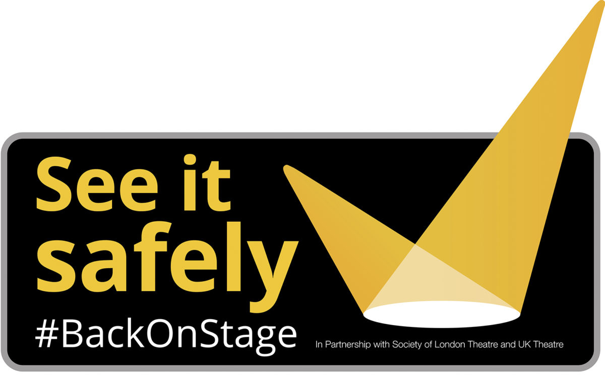 See it Safely logo, a tick formed from two stage spotlights